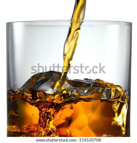 Pouring Scotch Whisky in Glass with perfect ice isolated on white - stock photo
