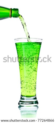 pouring soda in glass isolated on white - stock photo