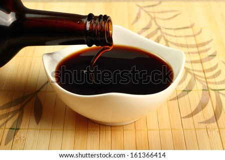 Pouring Soy Sauce into bowl - stock photo
