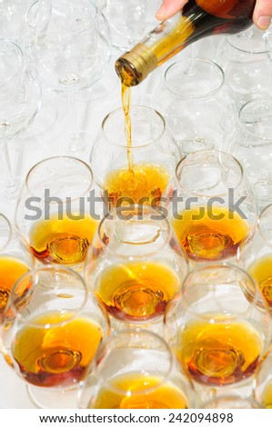 pouring the brandy or cognac - stock photo