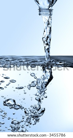 pouring water from a bottle - stock photo