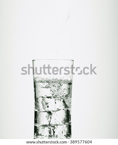 Pouring water into a glass - stock photo