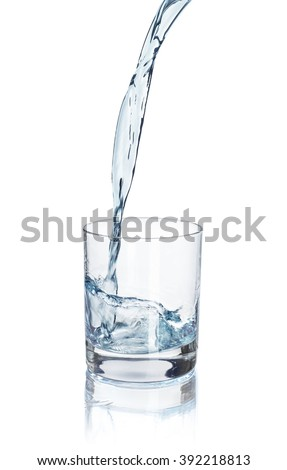 pouring water into a glass isolated on white background