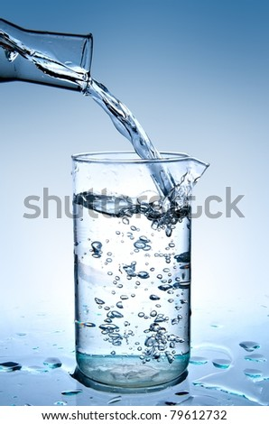 pouring water on blue background