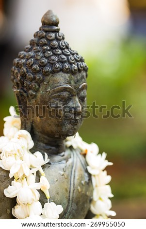 Pouring Water on Buddha Statue during Songkran Festival in Thailand - stock photo