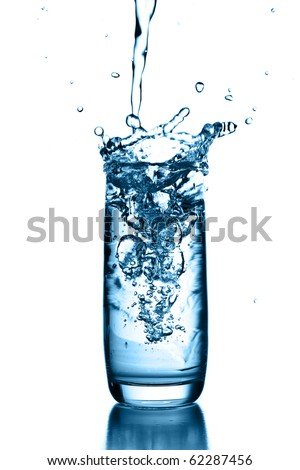 pouring water on glass - stock photo