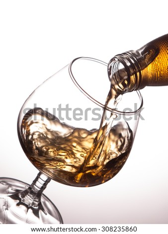 Pouring whiskey into a glass