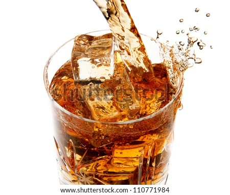 Pouring whiskey into glass full of ice cubes