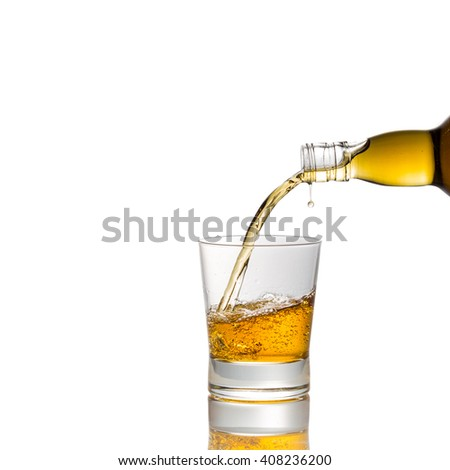pouring whiskey into  glass isolated on white - stock photo