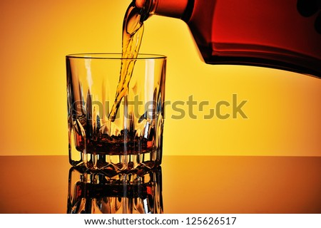 Pouring whisky into a glass