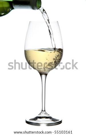 Pouring white wine - stock photo