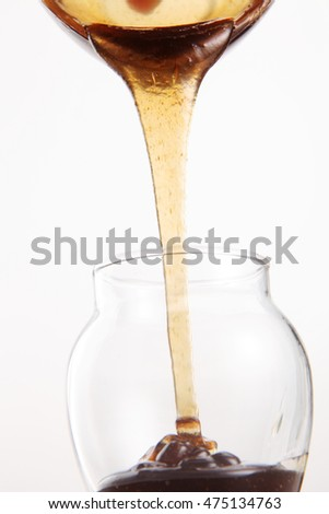 pouring wild honey on the white background