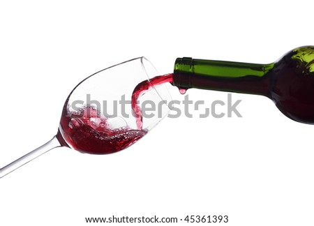 pouring wine into a glass isolated on white - stock photo