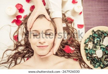 pov massage. woman enjoys facial massage at the spa. concept about beauty, body care, and people - stock photo