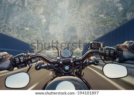 POV shot of young man riding on a motorcycle