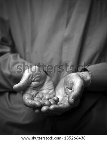 Poverty. Wrinkled empty old hands - stock photo