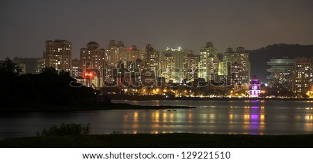 Powai, Mumbai looking over Powai lake at night. - stock photo