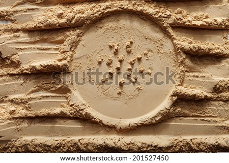 powder background with a with the trace of the lid loose powder - stock photo