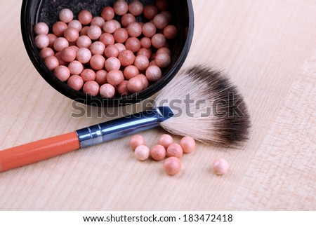 Powder balls on wooden background - stock photo