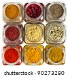 powder colorful spices in glass bottle close up , top view,  isolated on white background - stock photo