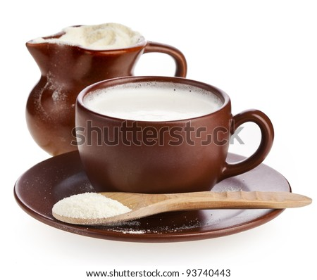 powder milk in  clay  pitcher and cup on white background - stock photo