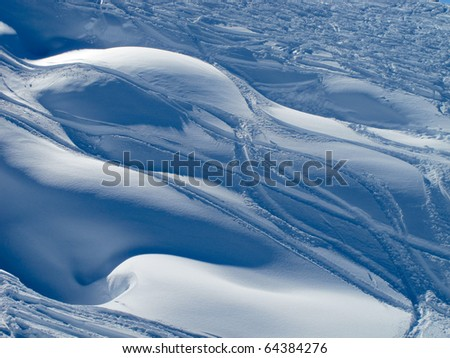 Powder snow and ski trails ST Gervais French alps France - stock photo