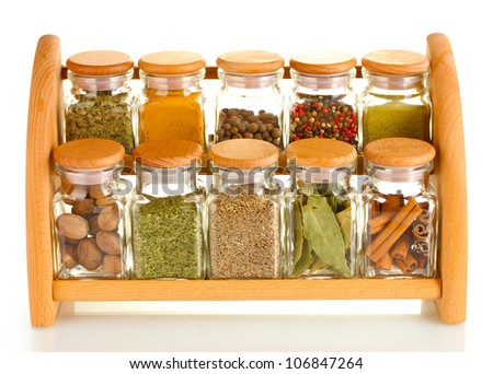 powder spices in glass jars on wooden shelf isolated on white