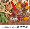 Powder spices on spoons in wooden background - stock photo