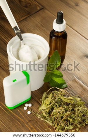 Powder stevia and liquid, dried and tablet forms on a wooden table - stock photo