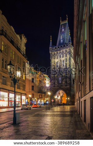 Powder Tower at night, built in 1475, a high Gothic tower in Prague, Czech Republic