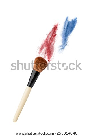 powderbrush isolated on white background with colofull dust - stock photo