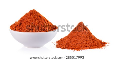 Powdered dried red pepper in a white bowl on white background