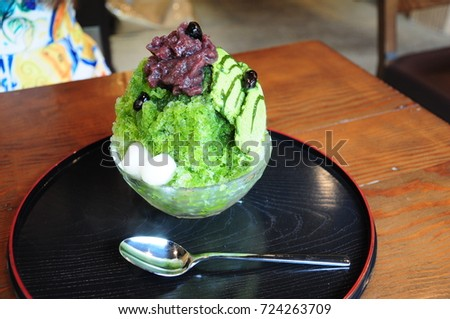 https://thumb1.shutterstock.com/display_pic_with_logo/167494286/724263709/stock-photo-powdered-green-tea-and-bean-shaved-ice-724263709.jpg