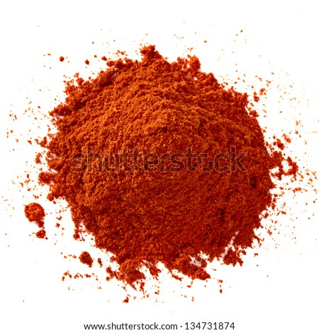 Powdered pimienta roja red pepper pile from top on white background - stock photo
