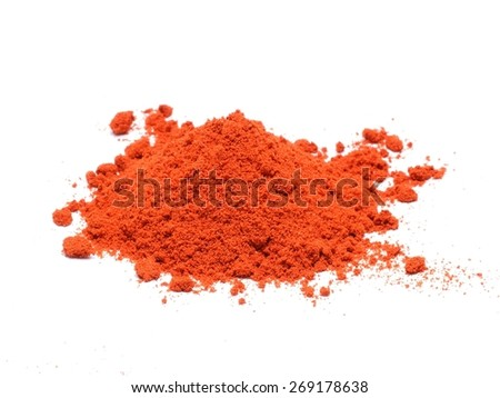 Powdered pimienta roja red pepper pile on white background