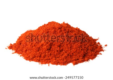 Powdered red pepper on white background - stock photo