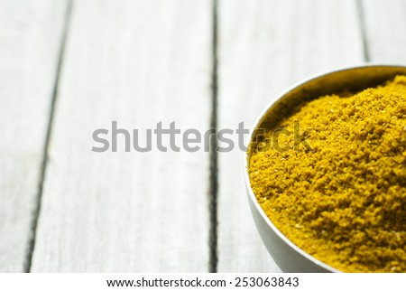 powdered spices on rusty wooden table