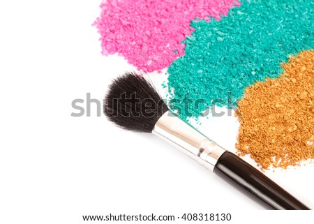 Powdery eyeshadow makeup and brush on a white background - stock photo