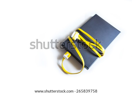 Power bank and USB yellow on white background , small device that have electricity to recharge many kind of smart phone via USB - stock photo