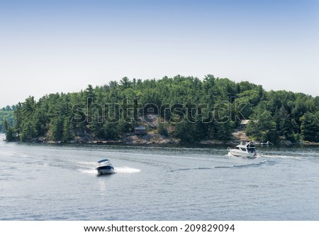 Power boats in a curve - stock photo