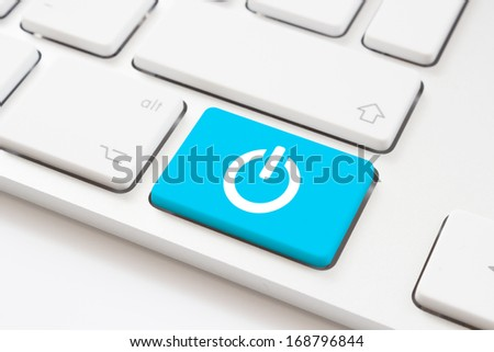 Power button key on a white keyboard - stock photo