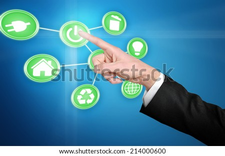 Power button pressed by hand - stock photo