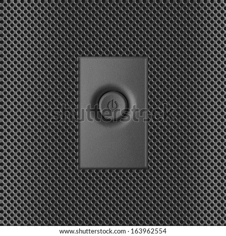 Power control concept. Close up of one dark gray plastic power button with embossed switch sign on the front panel makes as metal perforation of modern personal computer in shade silver color - stock photo