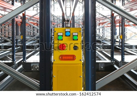 Power control of mobile shelving system in warehouse - stock photo