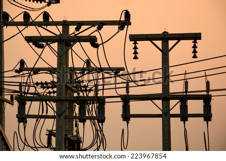 Power electric pole with sunset - stock photo