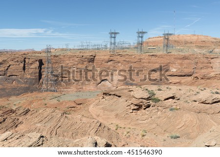Power Electric Substation Pylons in Stone Desert - stock photo