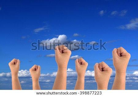 Power fist on sky-clouds background.