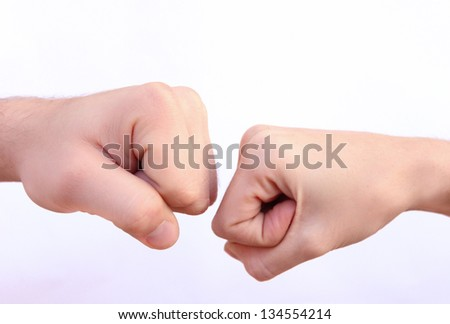 Power Fists: close-up of two hands knocking fists