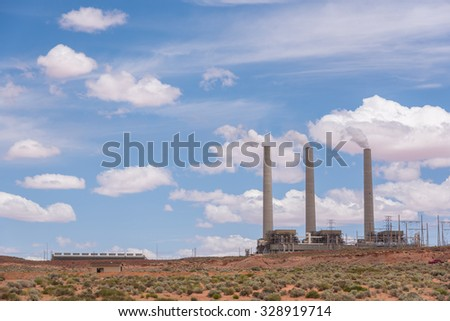 Power generating plant or coal mining plant in the desert under blue sky