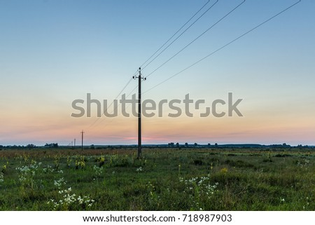 power grid in the background of the sunset